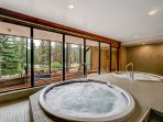 Soothe your muscles in the shared indoor hot tub