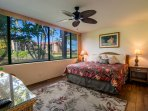 Master bedroom with comfortable King size bed, garden and partial ocean views!