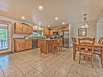 Spacious Full Kitchen with Granite Countertops, Bar Seating, Dining Area with Seating for 6, and a Private Deck with a...