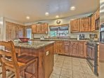 Fully Equipped Kitchen with Granite Countertops and Bar Seating