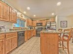 Fully Equipped Kitchen with Granite Countertops and Bar Seating, Dining Area with Seating for 6, and a Private Deck...