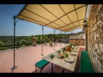Dining on terrace with views of countryside