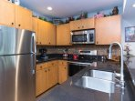 New, modern kitchen with granite countertops