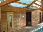 Sauna adjacent to full bath with jacuzzi tub