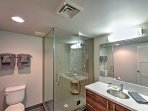 This pristine bathroom offers a spacious walk-in shower.