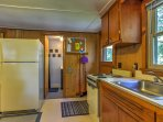 You'll find wood-paneled walls throughout the cabin, which gives the property a rustic feel!
