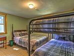 There is a full-sized bed and a twin-over-twin bunk bed in the second bedroom.