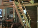 Ladder with hand rails to second floor sleeping loft.