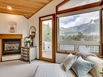 Master suite with king bed, fireplace, views