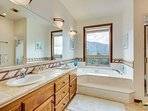 Master Bath with oval tub and shower and view