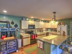 The main kitchen offers ample counter space, barstool seating and all the cooking essentials!
