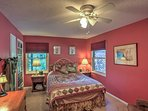 Sweet dreams! This pink room offers a queen bed.