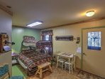 A twin-over-full bunk bed can be found in the mudroom, which also features a stove for extra winter warmth!
