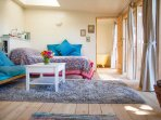 A luxurious comfy day bed and ensuite warm and sunny bathroom...