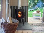 The wood-burning stove keeps Jake's Cabin cosy and can also heat the kettle!