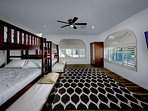 Bedroom with bunks and double size pull out underneath! Can sleep 12 and flatscreen TV