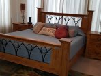 master bdrm with California King bed, room generously sized. Ceiling to floor drapes
