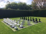 Giant outdoor chess, within secluded 'walled' garden.