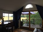 Windows give you 270° views of Delaware woodwinds and 80 acres of farm fields.  Balcony off