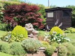 great gardens in the garden shed is the bar a q  also sun loungers
