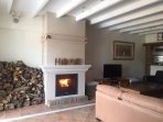 Relax & watch television in front of the log-burner