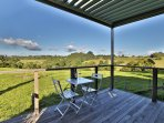 Your private villa deck opens onto the lush rolling countryside.