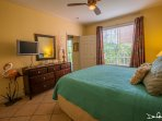 beach front condo; spacious master bedroom with TV
