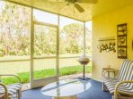 Enjoy a peaceful retreat on your private lanai in this charming gated condo community.