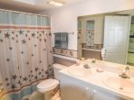 Private master bath with double sinks and full walk in shower.