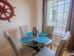 Dining area with full size kitchen appliances