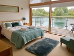 Master bedroom has stunning views over the lake and an outside balcony