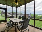 Lower level screened in patio with dining table.