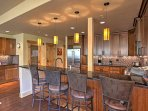 Two dining areas include the kitchen eat-in counter and 6-person dining table.