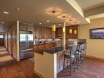 The fully equipped kitchen features Viking stainless steel appliances.