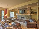 A stunning stone fireplace serves as the living room focal point.