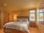 The master suite features a plush king-sized bed.