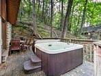 Soak away any worries in the private hot tub.