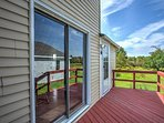 Step through the sliding glass door onto the back deck.