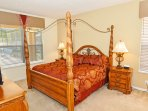 Master Suite 1 with king-size bed, TV & en-suite bathroom (ground floor)