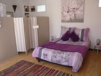 large sunny bedroom with ensuite bathroom