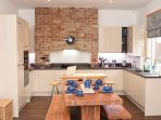 Kitchen diner with ample space for large groups to cook and dine in comfort