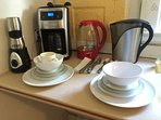 The kitchen comes with everything you need: coffee maker, oven, utensils, stove, pots and pans etc.