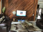 Newly renovated TV area with teak wood feature wall.