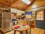 The kitchen features granite countertops and new appliances.