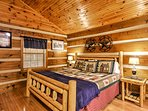 You'll sleep peacefully on this king-sized log bed.