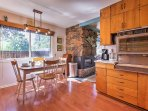 Enjoy breakfast with loved ones at the dining table in the kitchen with seating for 8 (expansion leaf in coat closet).