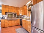 Cook at home with ease in the fully equipped kitchen with a stainless steel refrigerator and plenty of cabinet space.