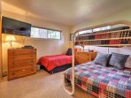 Kids will enjoy the second bedroom which features a twin-over-full bunk bed, a twin-sized bed, and a flat-screen cable...