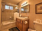 The third bathroom offers a shower/tub combo.
