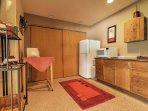 For additional sleeping accommodations, use a pull divider and convert the kitchenette into a queen bed room.